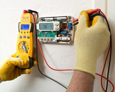 Electrician Installing a Component